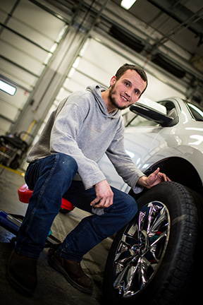 Lifeworks Associate Wyatt Kihlstrom puts the finishing touches on a vehicle during his shift at Chuck Spaeth Ford.
