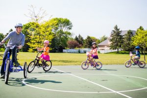 Louis McManus and his siblings ride their bikes.