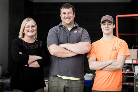 Lifeworks job coach Chelsea Skinner, Vice President Andrew Javens, and Electrical Apprentice and Lifeworks Associate Josh Meagher