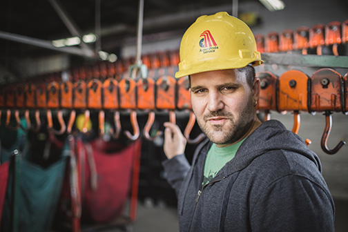 Lifeworks Associate Brian Kley works in the warehouse at AmeriPride