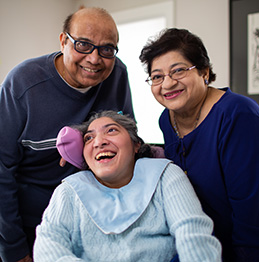 Father, mother, and daughter smiling. Lifeworks Personal Support and Respite.